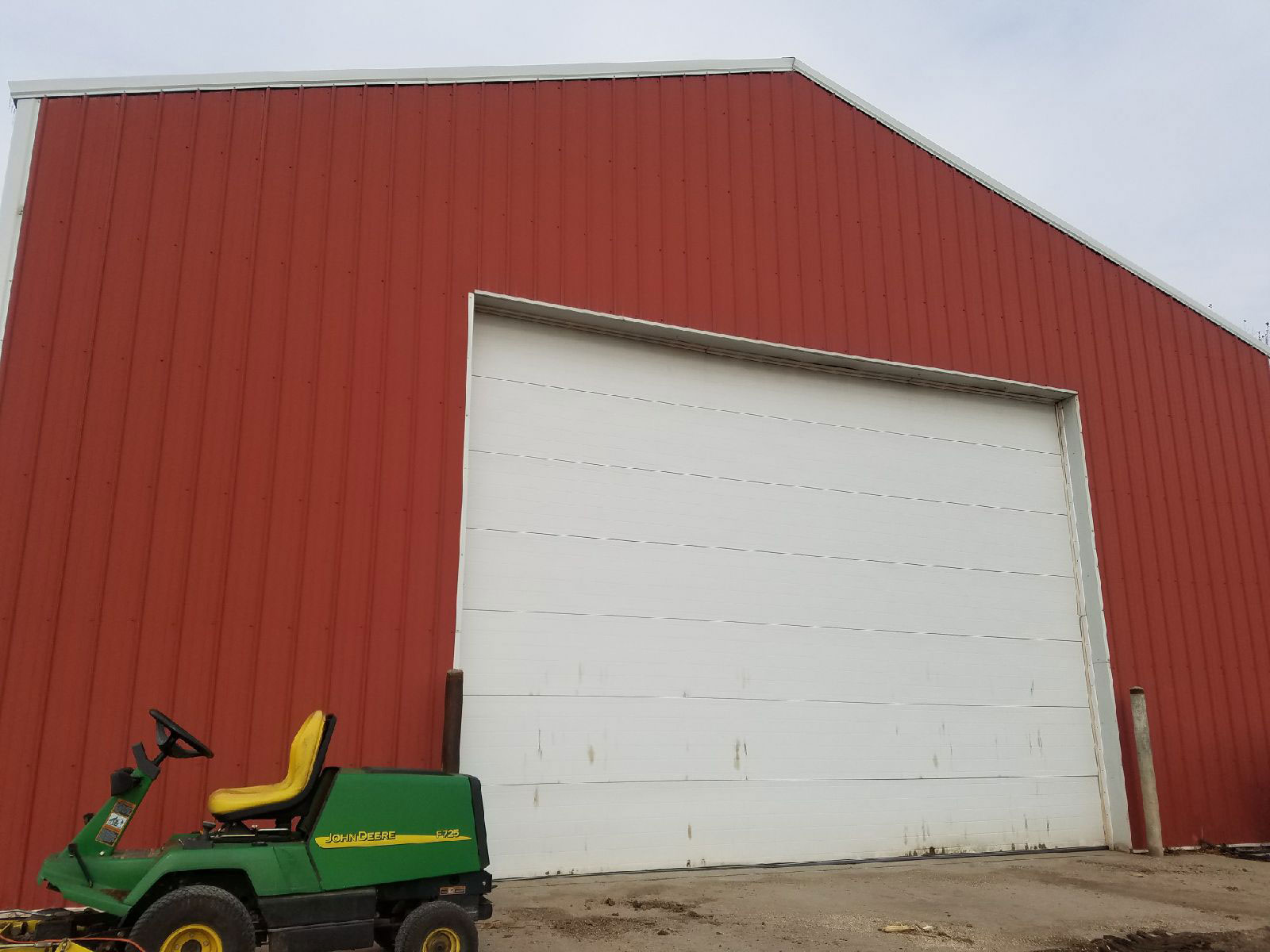 Front of barn with green tractor